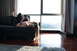 Lovely Blond Woman Listening To Music while resting on couch - 173161645