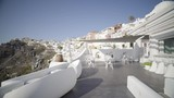 4k travel video dolly move terrace of luxury hotel in fira santorini island of greece on sunny summer day with blue sky without people - 173169243