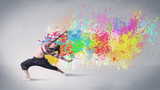 Young colorful street dancer with paint splash - 173181071