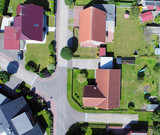 Aerial photo with the drone, anew build-up plot with single houses and gardens, narrow neighborhood - 173198829