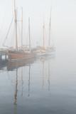 Wooden vintage ships on a foggy morning. - 173220803
