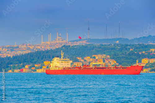big ship passes through the Bosphorus strait, on a sunset, Istanbul Poster