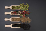 Different exotic spices on a black background - 173283047