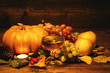 pumpkins, grapes and grape juice, apples. on a wooden surface