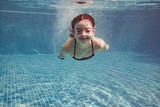 Little girl diving in a pool - 173295027