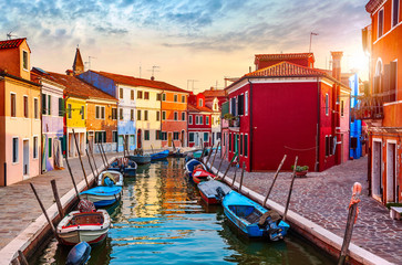 Burano island in Venice Italy picturesque sunset over canal © Yasonya