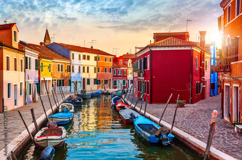 Fototapeta Burano island in Venice Italy picturesque sunset over canal