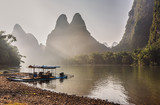 Bamboo boat on the famous Li river in China, with  beautiful karst landscape. - 173312244