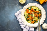 Spaghetti with roasted pumpkin and spinach.Top view. - 173336008