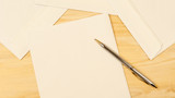 Mail envelopes and pen on the table mail concept - 173380475