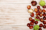 chestnut on white wooden background with copy space for your text. Top view - 173398045