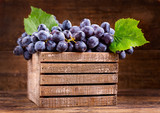 fresh grape with leaves in a wooden box