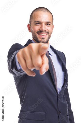 Poster Handsome businessman pointing the finger at you, isolated on a white background