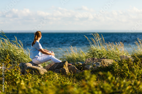 Woman relaxing at seaside