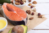 Healthy food vegetables , nuts and salmon - 173425035