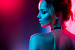 Beautiful sexy girl with trendy make-up in colorful bright lights