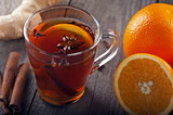 hot tea with spices and oranges - 173458090