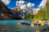 Fototapety Morning light on colorful canoes along the shore of Moraine Lake, Banff National Park, Alberta, Canada.