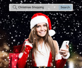 Woman wearing a Christmas dress using a mobile phone - 173473265