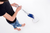 Young woman cleaning floor with modern steam cleaner. Isolated image on white - 173474664