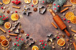 Holiday food background for baking gingerbread cookies with cutters, rolling pin and spices on vintage table top view. Copy space for christmas recipe.