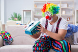 Drunk clown celebrating having a party at home - 173503878
