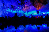 Illuminated lake in Reed flute cave in Guilin, China. - 173517847