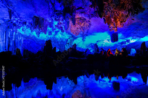 Illuminated lake in Reed flute cave in Guilin, China. Poster