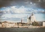 Symbol Venice vintage, Venetian bridge with Punta della Dogana and Basilica di Santa Maria della Salute, background Venice in Italy with church Salute, Venetian panorama with Santa Maria della Salute