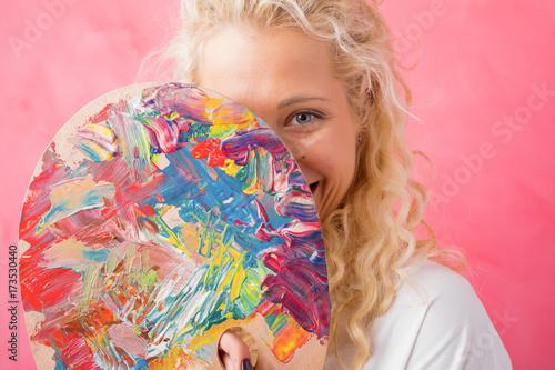 Artist hiding behind paint palette