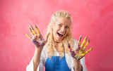 Happy painter with paint on her hands - 173530844
