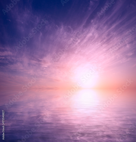 Foto op Aluminium Lichtroze A gentle sunset among the cumulus clouds at the end of the