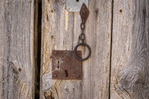 Closeup Vintage Door Lock Of External Antique Wooden Door Weathered On A  Country House