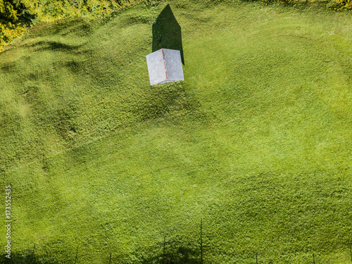 Aluminium Pistache Aerial view of mountain cottage in Swiss mountains