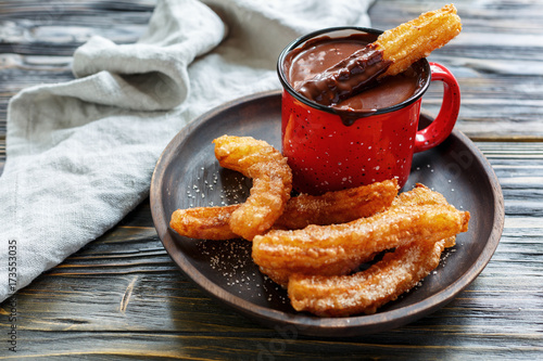 Fotobehang Chocolade Churros with sugar and cinnamon and hot chocolate.