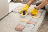 laying of paving slabs - 173562807