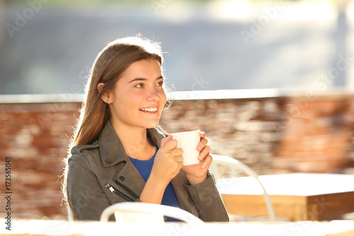 Happy teen resting in a coffee shop