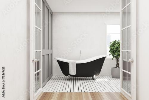 White bathroom, black tub, tree