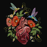 Embroidery anatomical heart, humming birds and poppies on black background. Elegant flowers poppy and tropical humming bird vector. Decorative floral embroidery - 173629419