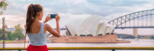 Staande foto Sydney Australia Sydney travel tourist woman at Opera House panoramic banner landscape crop. Asian girl taking photos with mobile phone during summer vacation trip.