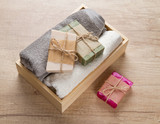 Handmade soap and towels in wooden box - 173641883