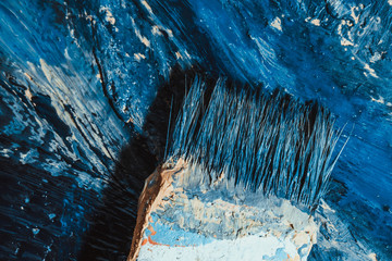 abstract blue paint strokes on the background