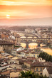 Quadro Aerial view of Florence at sunset  with the Ponte Vecchio and the Arno river, Tuscany, Italy