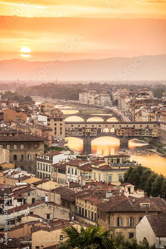 Tuinposter Florence Aerial view of Florence at sunset with the Ponte Vecchio and the Arno river, Tuscany, Italy