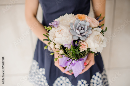 Woman holding beautiful floral bouquet no face Poster
