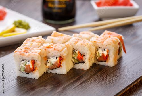 Fotobehang Sushi bar Sushi rolls served on wooden slate