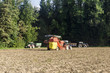 Potato harvester harvesting potatoes on field