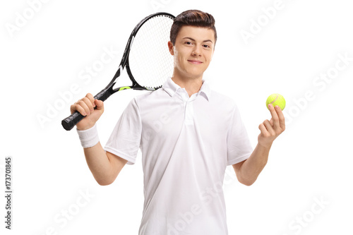 Teenage tennis player with a racket and a tennis ball