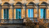 Row of window on an old building with dilapidated or damaged facade in Zagreb, Croatia
