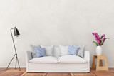 white sofa in front of plaster wall with lamp and flower 3d rendering - 173720815